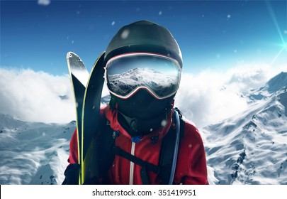 Skier in front of mountain landscape
