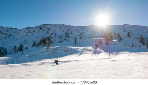 skier go down on the snowy ski track at Sauze D'Oulx piedmont Italy