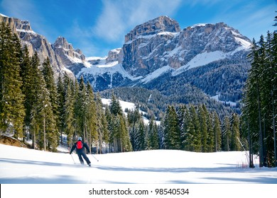 Skier going down the slope at Val Di Fassa ski area in Italy