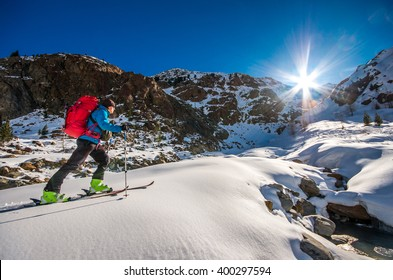 Skier going through the valley into the mountains
