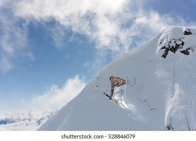 Skier jump on mountains. Extreme sport.