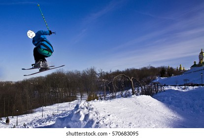 Skier is jumping. Extreme jump. Mask troll.