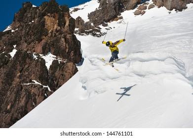 Skier jumping on snow cornices.