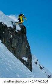 Skier jumping on the stones, powder snow, off piste
