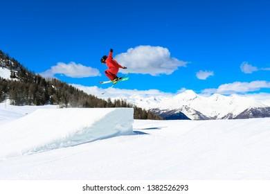 Skier jumping in ski resort in Italy