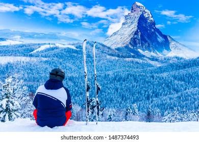 A skier is looking the Monte Rosa Massif from Gornergrat's view point (Zermatt, Canton of Valais, Visp, Switzerlan, Europe)