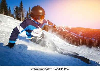 Skier man skiing downhill in high mountains, photo action camera
