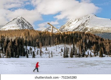 Skier mastering his cross country skiing skills on a frozen lake against High Tatras mountains on a beautiful sunny day, 2013 March 17, Strbske Pleso, Slovakia.