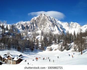 Skier and Mountain - blue bird day