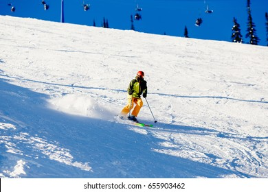 Skier mountain skiing riding on track slope. Concept active rest in winter, photo in motion, snow is scattered. Sheregesh ski resort