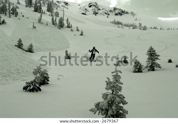 Skier next to avalanched slopes