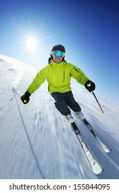 Skier on pise in high mountains