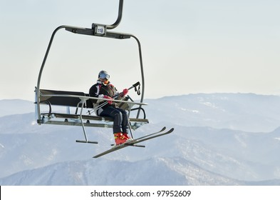 Skier on ski lift at resort in Siberia