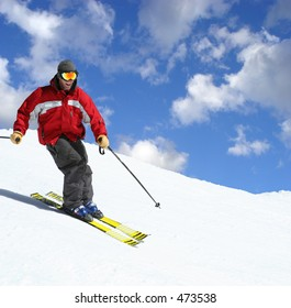 Skier on a slope against the cloudy sky
