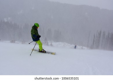 Skier on a steep snowy slope, winter blizzard in the mountain, Aleko Ski Resort, Vitosha, Bulgaria