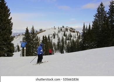 Skier pausing on slope before skiing down;  Steamboat Springs, Colorado
