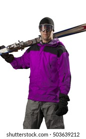 Skier with a pink jacket, holding a pair of skis on a white background.
