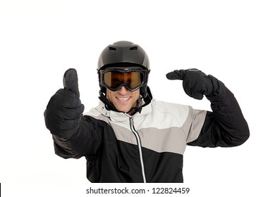 Skier pointing to his helmet with thumb up