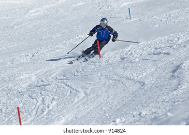 Skier racing down the hill at youth competition
