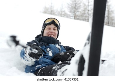 Skier resting in the snow