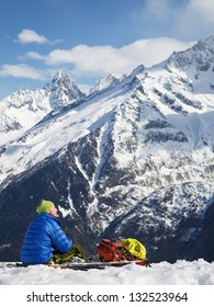 Skier resting in the sun.