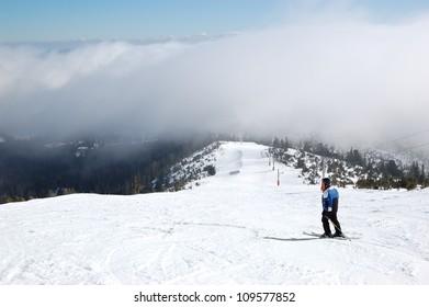 Skier rides on a slope in Strbske Pleso ski resort, High Tatras, Slovakia