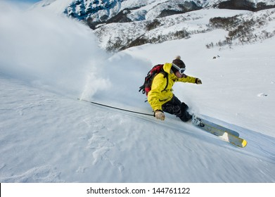 Skier skidding in the snow, off piste.