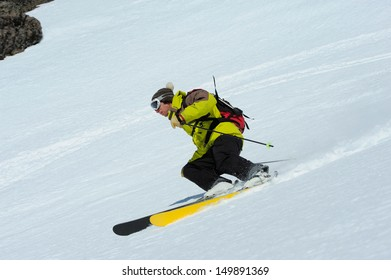 Skier skidding in the virgin snow, off piste.