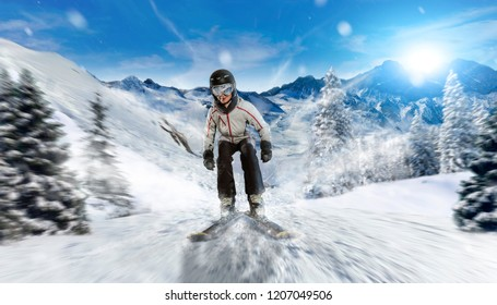 skier slides downhill over new powder snow. high speed ski racing in winter ski resort. panoramic mountain and forest environment with snow fall