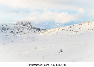 Skier in a snow covered mountain landscape in Beitoslølen Norway