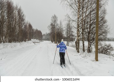 skier in the snow-covered forest in Karelia