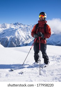Skier standing in front of mountains in Chamonix