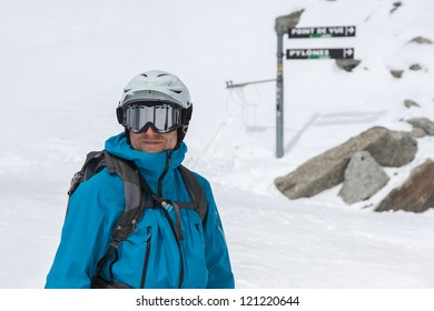 Skier standing at top of slope in Chamonix, France