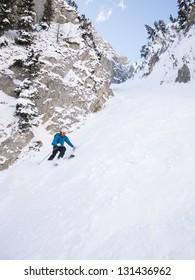 Skier in steep chute.