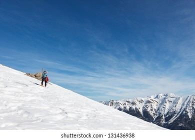 Skier taking photograph of mountains.