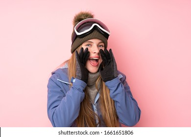 Skier teenager girl with snowboarding glasses over isolated pink background shouting with mouth wide open