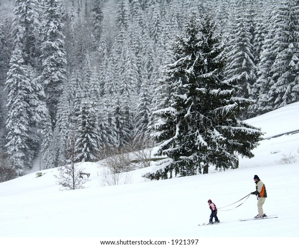 Skiers against a snowy background.