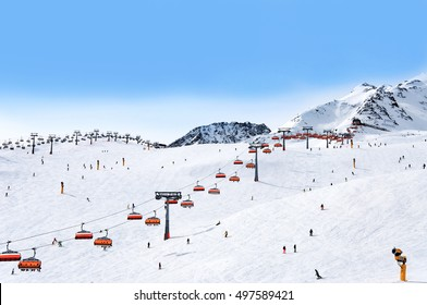 Skiers and chairlifts in Alpine ski resort in Solden in Otztal Alps, Tirol, Austria