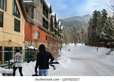 Skiers Coming back to Townhomes After a Day on the Mountain