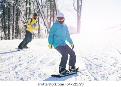 Skiers couple skiing in the mountains