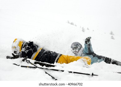 Skiers girls playing in the snow