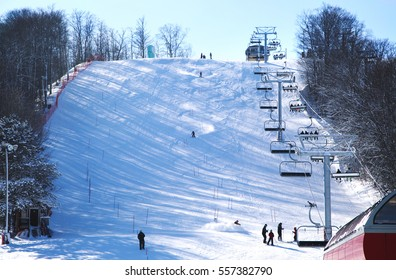 Skiers going down the slope at Horseshoe ski resort in Barrie, Ontario, Canada