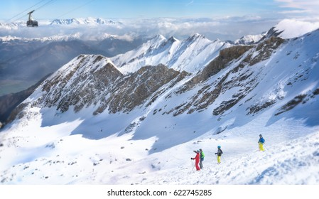 Skiers looking at the beautiful landscape.