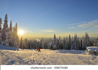 Skiers on Grouse Mountain Ski Hills at sunrise, Vancouver, BC