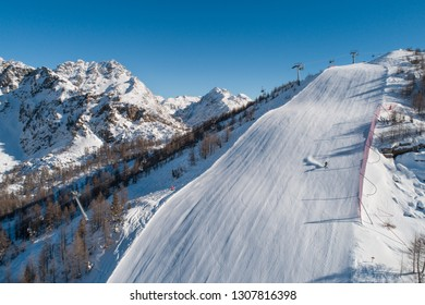 Skiers on the ski slope, ski resort in Valtellina.