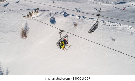 Skiers on skilift view from above. Ski resort in Europe
