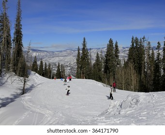 Skiers on a slope; Snowmass, Colorado
