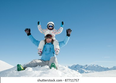 Skiers playing in snow (copy space)