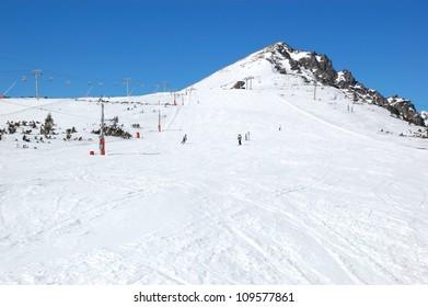 Skiers riding on a slope in Strbske Pleso ski resort, High Tatras, Slovakia