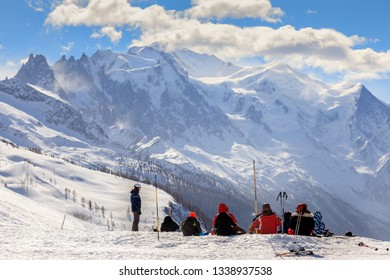 Skiers sitting down looking at Mont Blanc in the French Alps